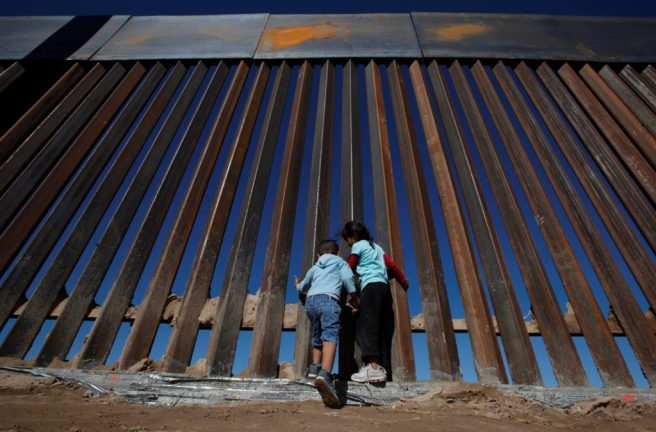 Children play at a newly built section of the U.S.-Mexico border wall at Sunland Park, U.S. opposite the Mexican border city of Ciudad Juarez
